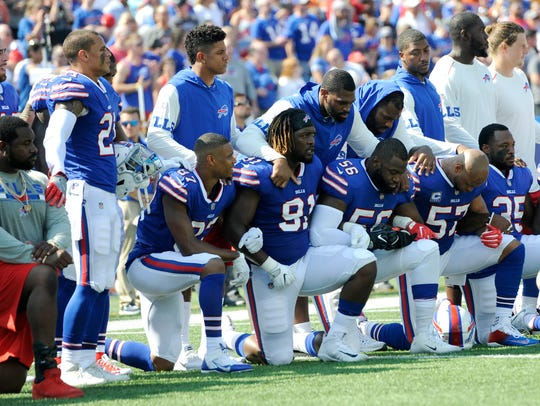 Buffalo Bills players take a knee during the national