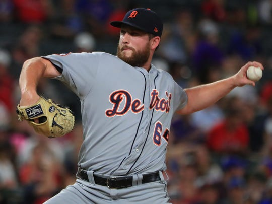 Tigers pitcher Chad Bell throws in the bottom of the fourth inning of the Tigers' 12-6 loss to the Rangers on Wednesday, Aug. 16, 2017, in Arlington, Texas.
