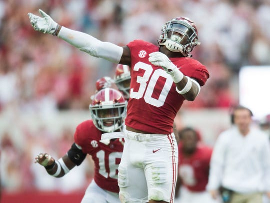 Alabama linebacker Mack Wilson (30) celebrates an interception