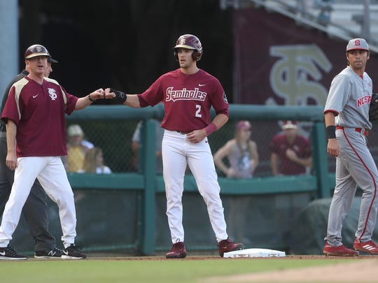 FSU's Jackson Lueck first bumps coach Mike MArtin Jr.
