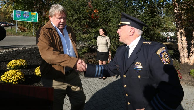 Brian Lennon, left, greets Rockland County Undersheriff Robert Van Cura before the 34th annual Brinks Memorial Service in Nyack Oct. 20, 2015. Lennon was a South Nyack Police Officer who survived the Brinks bank robbery in 1981.