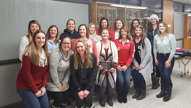 Longtime Westfall volleyball coach Lori Koker stands with a group of former student-athletes who played for her as Mustangs. Koker was inducted into Westfall High School's Athletic Hall of Fame this past Friday.