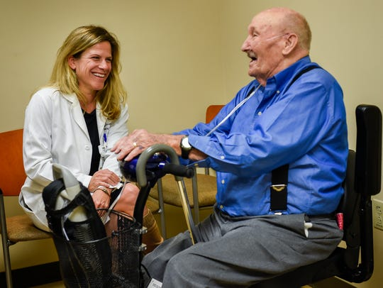 Dr. Tracy Jackson talks with patient Johnson Sadler