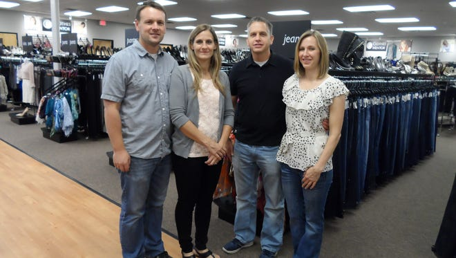 The Avondale Clothes Mentor resale fashion store is owned by (from left) Matt and Emily Smith and their financial partners Ryan and Dana Broderick.