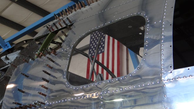 The nose section of the dismantled B-17 bomber housed in a hangar at Salem Municipal Airport has been restored.