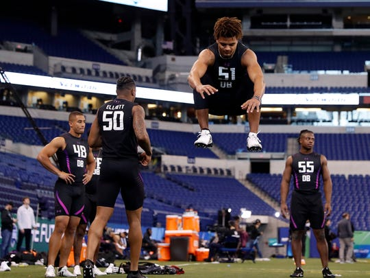 Alabama Crimson Tide defensive back Minkah Fitzpatrick jumps up to stretch out his legs before doing the broad jump during the 2018 NFL Combine at Lucas Oil Stadium.