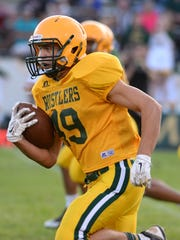 CMR running back Isaiah Chargois carries the ball in Friday night's scrimmage at Memorial Stadium.