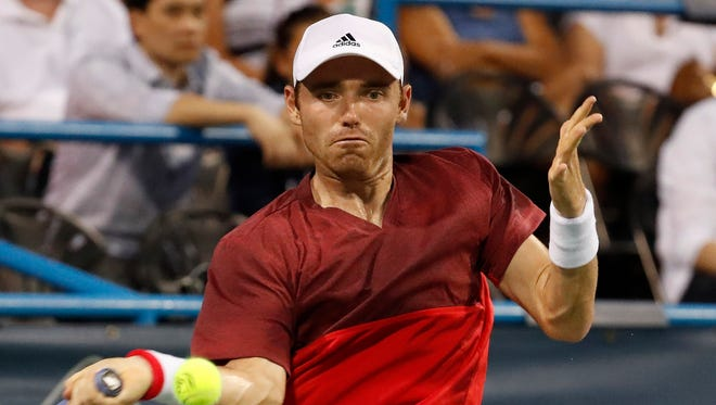 Bjorn Fratangelo of the United States, a former Barron Collier High School player,  hits a forehand against Sam Querrey of the United States (not pictured) on day two of the Citi Open at Rock Creek Park Tennis Center. Query won 6-7(5), 6-4, 6-4, on July 19, 2016, in Washington, D.C.