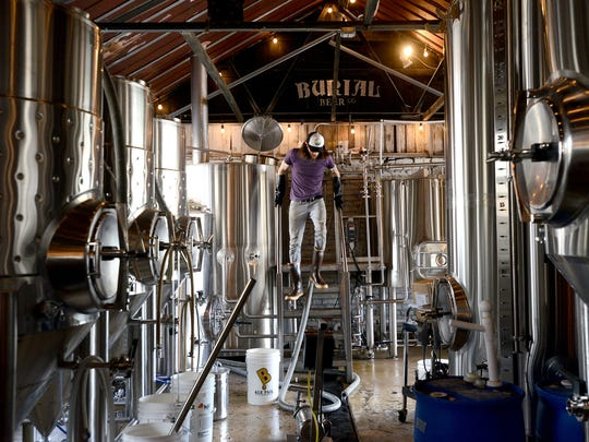 Tim Gormley, head brewer at the Burial Beer Company taproom, works Thursday in the brew house as preparations are made for Saturday's party. The taproom is collaborating with Buxton Hall for a party to debut its beer garden.