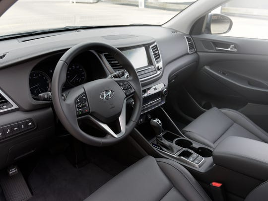 The 2016 Hyundai Tucson's interior offers plenty of passenger space and features including a touch screen and navigation.