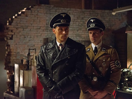 John Smith (Rufus Sewell), left, and Erich Raeder (Aaron