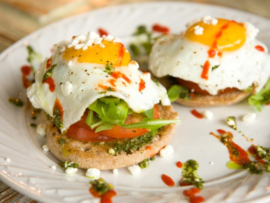 Avocado toast with fried egg, tomato, some micro greens