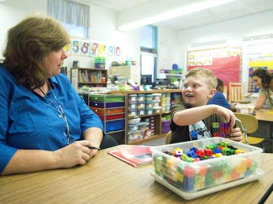 Kindergarten teacher Lauri Burton talks a student in this file photo from last year.