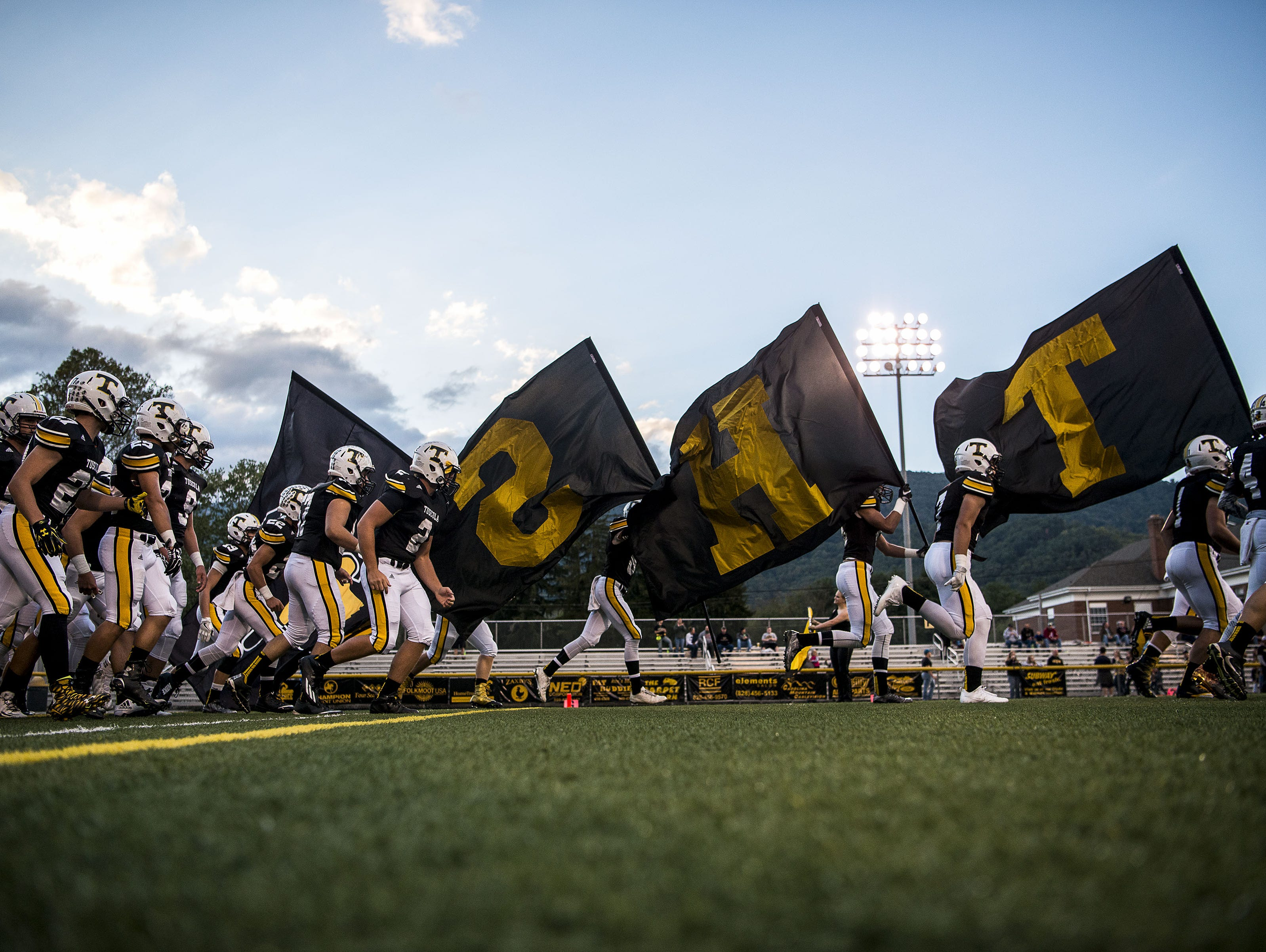 Tuscola players take the field for last week's home win over Brevard.