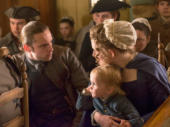 """Skylar Lanier (back, center) was an extra in two episodes of the AMC television show """"Turn: Washington's Spies."""""""