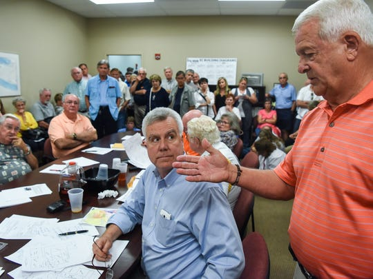Rick Glover, right, makes a point near board member Dan Harvell, middle, during a Anderson County Land Use and Zoning Board of Appeals meeting at the Anderson County Courthouse Annex in Anderson on Thursday.