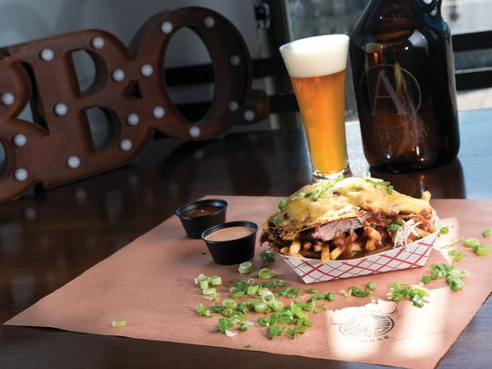 Cholander Fries with Brisket paired with Alementary 'Trophy Wife' beer