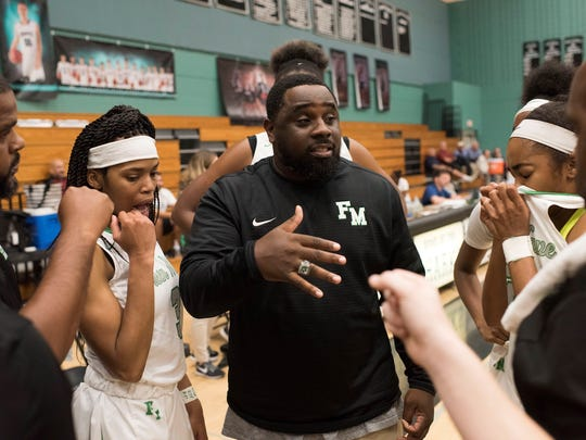 Fort Myers coach Chad Terrell addresses his team  in the Green Wave's 53-48 win over  Newtown (Pa.) Council Rock North Thursday in the Naples Holiday Shootout.