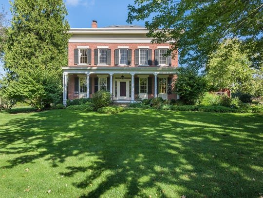 The North Salem, N.Y., home, a stately brick 1838 Greek Revival, is the centerpiece of a 25-acre equestrian property known as Autumn Farms.
