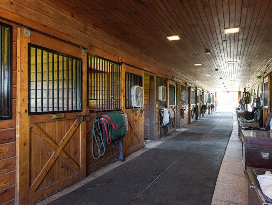 The equestrian center includes two stables with tack rooms and stalls for 25 horses.