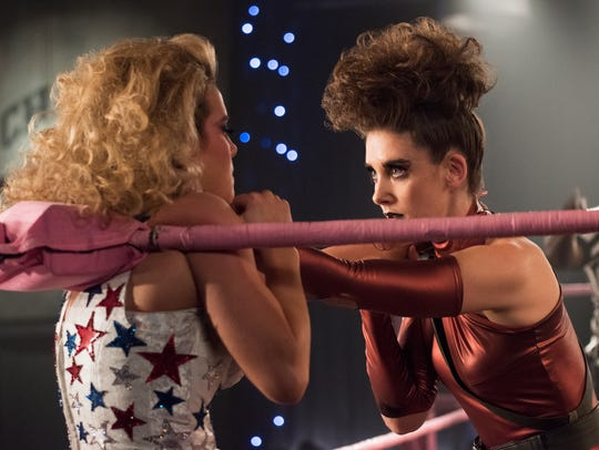 "Betty Gilpin as Debbie and Alison Brie as Ruth duke it out in this image from the second season of ""GLOW."""