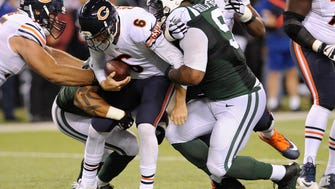 Chicago Bears quarterback Jay Cutler (6) is sacked by New York Jets defensive end Sheldon Richardson (91) in the third quarter of an NFL football game, Monday, Sept. 22, 2014, in East Rutherford, N.J. (AP Photo/Bill Kostroun)  ORG XMIT: ERU