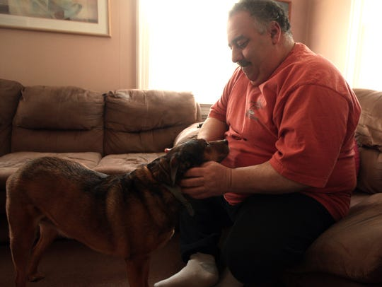 Rob Miscia with his dog Mocha. Miscia, a 49-year-old