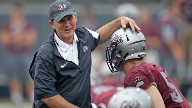 Montana's head coach Bob Stitt greets his players during pregame prior to his first game as Grizzly head coach, Aug. 29, 2015, against North Dakota State in Missoula. The Grizzlies won 38-35 in thrilling fashion.