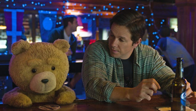 "Ted (Seth MacFarlane) and John (Mark Wahlberg) catch up over a few beers in ""Ted 2."""