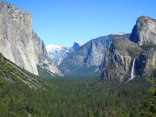 This April 2013 image shows Yosemite Valley as seen from Tunnel View with three of Yosemite National Park's best-known attractions: The El Capitan summit on the left, the granite peak known as Half Dome in the distant center, and Bridalveil Fall on the right.
