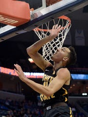 Wichita State guard Landry Shamet (11) shoots during the second half of the team's NCAA college basketball game against Memphis on Tuesday, Feb. 6, 2018, in Memphis, Tenn. (AP Photo/Brandon Dill)