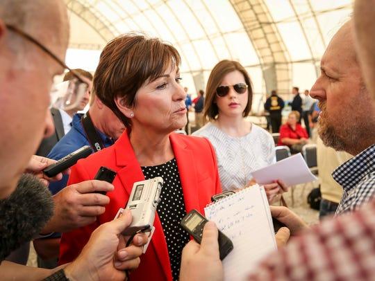 Gov. Kim Reynolds talks to members of the media following