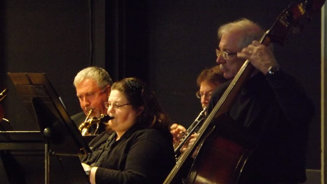 Kristopher Baker, Amy Bryant, Scott Zimmerman and Mike Mustin perform with Richmond Community Orchestra.