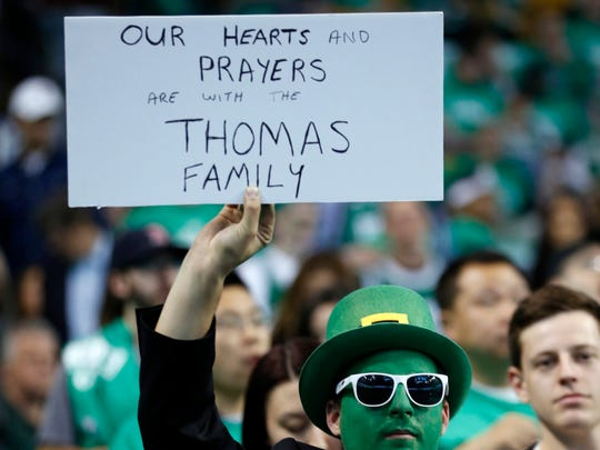 A Boston Celtics fan holds a sign for point guard Isaiah Thomas during the first quarter in Game 2 of the first round of the 2017 NBA playoffs against the Chicago Bulls at TD Garden.