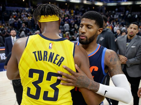Oklahoma City Thunder Paul George (13) greets Indiana