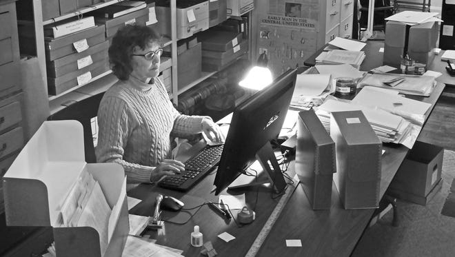 Kathy Engel works on the computer at the South Wood County Historical Museum.