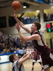 Southern Fulton Indians Dylan Gordon (30) shoots the ball while being guarded by Shanksville Vikings CJ Salisgiver (14) during PIAA District 5 Class A boys basketball championship on Friday, March 3, 2017 played at Pitt-Johnstown Sports Center in Johnstown, Pa. Shanksville defeated Southern Fulton