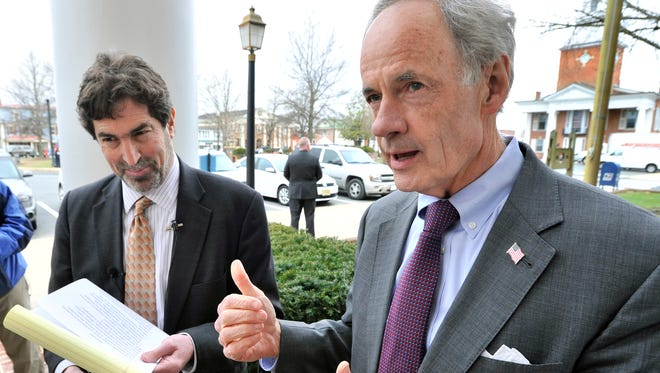 Sen. Tom Carper (right), with Delaware Law School professor Alan Garfield, holds a press conference in Georgetown on Monday morning denouncing Republicans' refusal to meet with any Supreme Court nominee until after the presidential election.