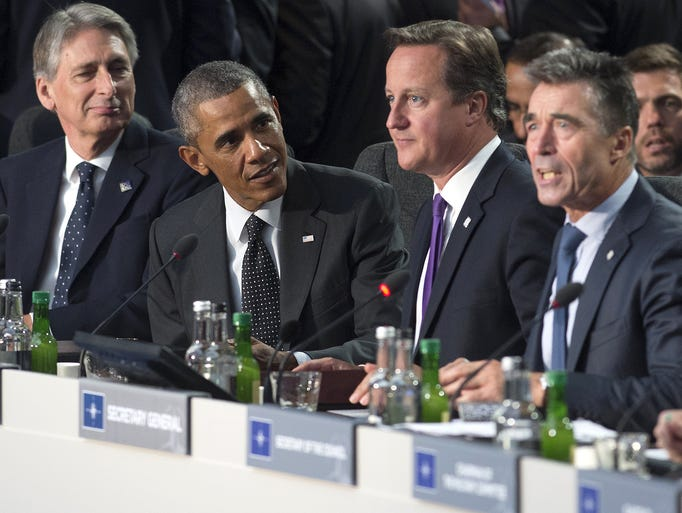 British Foreign Secretary Philip Hammond, left, President Obama, British Prime Minister David Cameron and NATO Secretary-General Anders Fogh Rasmussen attend a meeting on Afghanistan  on the first day of the NATO 2014 summit on Sept. 4 at the Celtic Manor Resort in Newport, Wales.