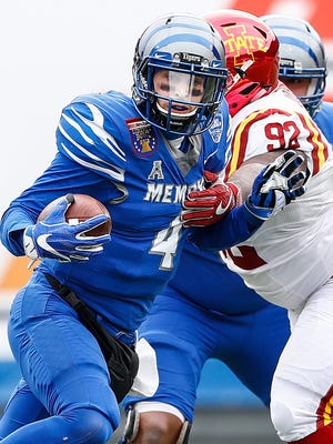 Memphis quarterback Riley Ferguson (left) is stopped short of a first down by Iowa State defender Jamahl Johnson (right) during second quarter action of the AutoZone Liberty Bowl in Memphis, Tenn., Saturday, December 30, 2017.