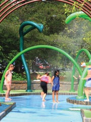 Children cooling themselves off running through the Mystic passage on a warm Spring day at Van Saun Park playground.