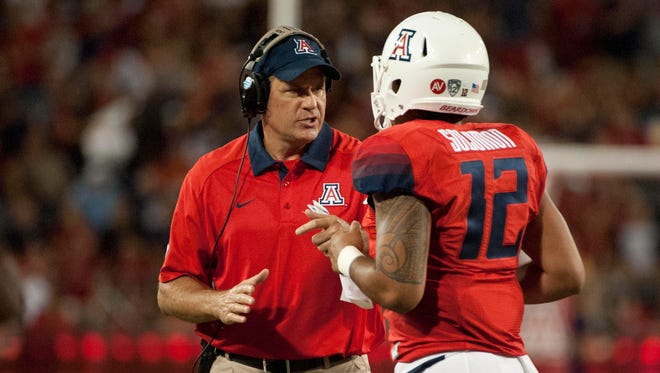 Sept. 19, 2015; Tucson; Arizona Wildcats coach Rich Rodriguez talks to quarterback Anu Solomon during the first quarter against the Northern Arizona Lumberjacks at Arizona Stadium.