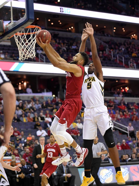 Indiana guard James Blackmon Jr., left, goes to the basket against Iowa forward Tyler Cook (5) during the first half of an NCAA college basketball game in the Big Ten tournament, Thursday, March 9, 2017, in Washington. Indiana won 95-73. (AP Photo/Nick Wass)