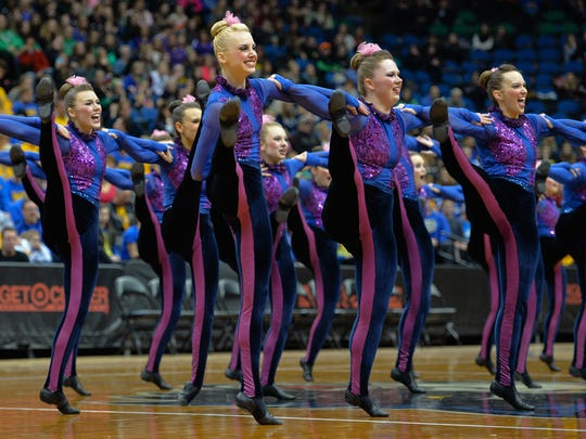 Sartell dancers perform in the state girls' Class 2A dance team tournament in the high kick division finals Feb. 14 at the Target Center in Minneapolis. Paige Seegers, who was diagnosed with asthma at age 3, is the second from the left in the front row.