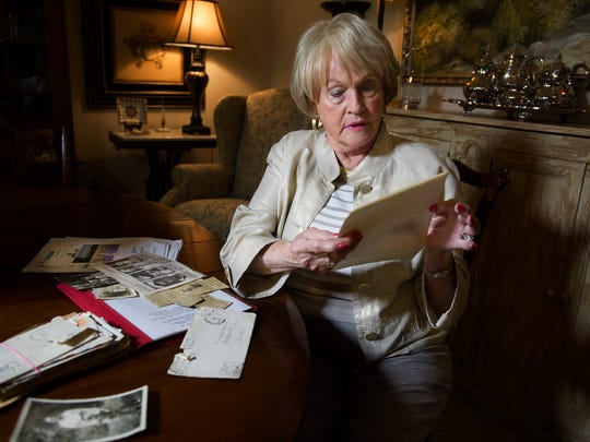 Janice Carlton reads a letter her brother wrote to their mother on Dec. 31, 1944, just two days before he was killed in action.