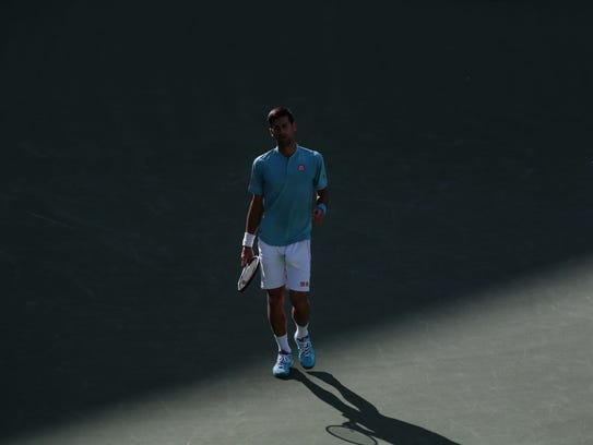 Novak Djokovic, of Serbia, reacts to a lost point to