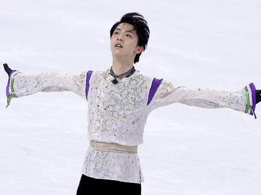 FILE - In this April 1, 2016, file photo, Yuzuru Hanyu, of Japan, competes during the free skate program in the World Figure Skating Championships, in Boston. Reigning men's gold medalist Hanyu will not participate in the team event that opens the figure skating program Friday, Feb. 9, 2018, as he continues to recover from an ankle injury he sustained in November. (AP Photo/Steven Senne, File)