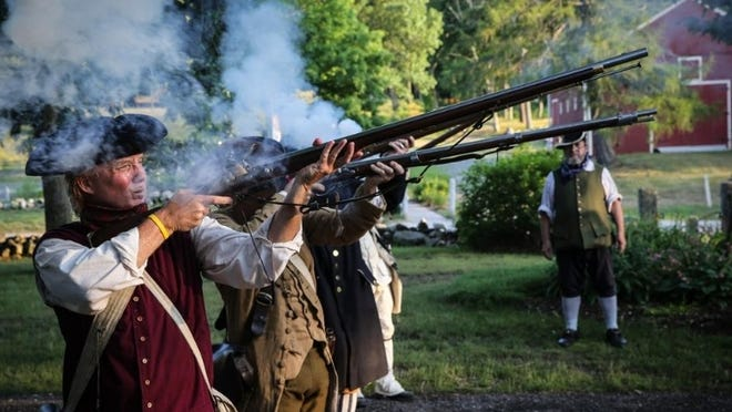 Members of the Sudbury Companies of Militia and Minute fire a musket salute on July 2 at Longfellow's Wayside Inn. The organization of the event is the subject of angst among top officers of the group.