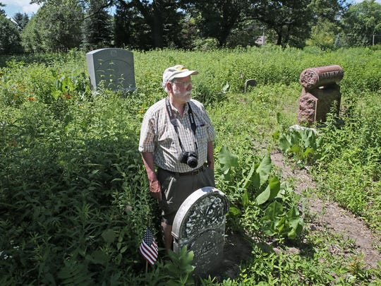 Dave Daley, a member of the Sons of Union Veterans of the Civil War, shows the headstone of Homer H. Clark, a lieutenant in the 16th U.S. Infantry who died of wounds suffered at the Battle of Chickamauga. The Civil War group says Muskego is not taking proper care of the cemetery where Clark and other Civil War vets are buried.