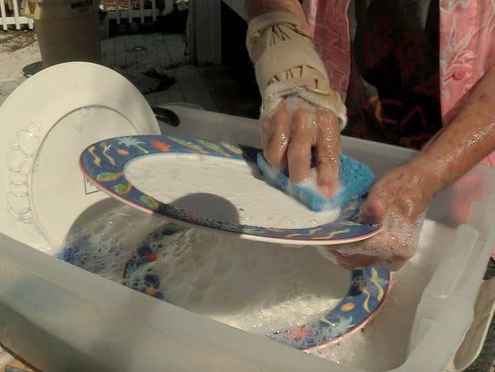 09/18/17-Marathon, Florida—Peggy Calkins washes dishes